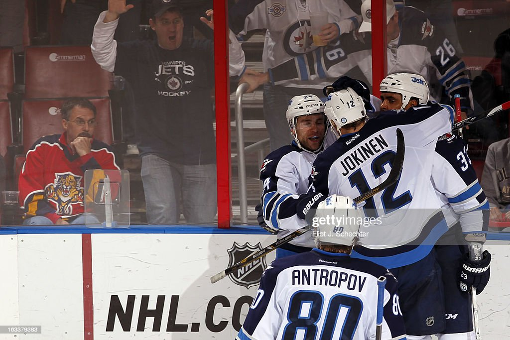 <a gi-track='captionPersonalityLinkClicked' href=/galleries/search?phrase=Dustin+Byfuglien&family=editorial&specificpeople=672505 ng-click='$event.stopPropagation()'>Dustin Byfuglien</a> #33 of the Winnipeg Jets is congratulated by teammates after scoring the game winning goal in over time against the Florida Panthers at the BB&T Center on March 8, 2013 in Sunrise, Florida.