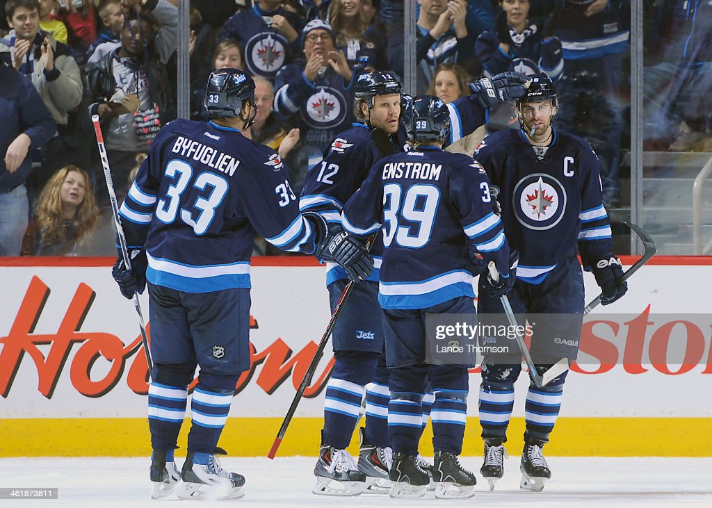 <a gi-track='captionPersonalityLinkClicked' href=/galleries/search?phrase=Dustin+Byfuglien&family=editorial&specificpeople=672505 ng-click='$event.stopPropagation()'>Dustin Byfuglien</a> #33 of the Winnipeg Jets joins teammates <a gi-track='captionPersonalityLinkClicked' href=/galleries/search?phrase=Olli+Jokinen&family=editorial&specificpeople=202946 ng-click='$event.stopPropagation()'>Olli Jokinen</a> #12, <a gi-track='captionPersonalityLinkClicked' href=/galleries/search?phrase=Tobias+Enstrom&family=editorial&specificpeople=2538468 ng-click='$event.stopPropagation()'>Tobias Enstrom</a> #39 and <a gi-track='captionPersonalityLinkClicked' href=/galleries/search?phrase=Andrew+Ladd&family=editorial&specificpeople=228452 ng-click='$event.stopPropagation()'>Andrew Ladd</a> #16 to celebrate a third period goal against the Columbus Blue Jackets at the MTS Centre on January 11, 2014 in Winnipeg, Manitoba, Canada.