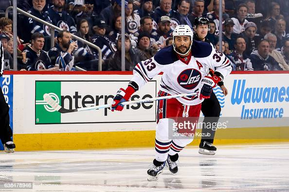 Dustin Byfuglien of the Winnipeg Jets keeps an eye on the play during second period action against the Calgary Flames at the MTS Centre on January 9...