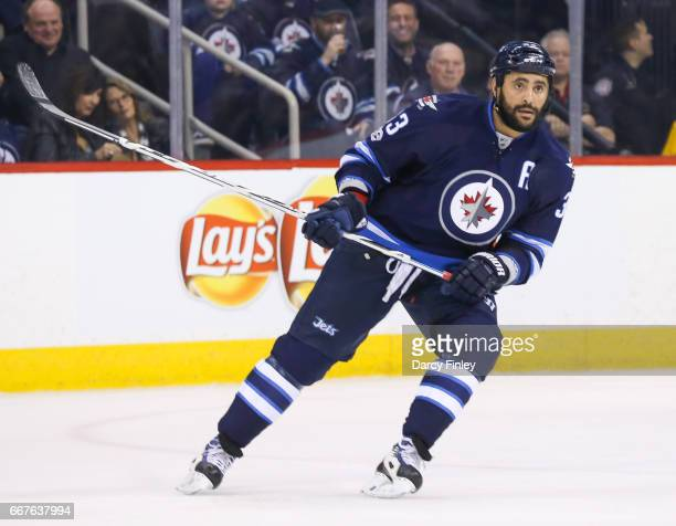 Dustin Byfuglien of the Winnipeg Jets keeps an eye on the play during second period action against the Nashville Predators at the MTS Centre on April...