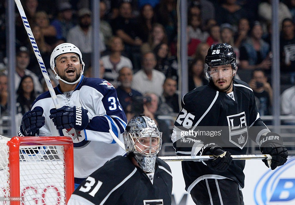 Dustin Byfuglien #33 of the Winnipeg Jets reacts to a missed chance in front of Martin Jones #31 and Slava Voynov #26 of the Los Angeles Kings at Staples Center on October 12, 2014 in Los Angeles, California.