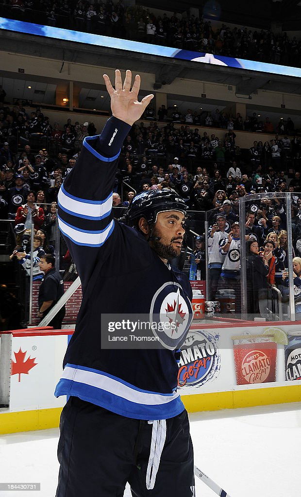 <a gi-track='captionPersonalityLinkClicked' href=/galleries/search?phrase=Dustin+Byfuglien&family=editorial&specificpeople=672505 ng-click='$event.stopPropagation()'>Dustin Byfuglien</a> #33 of the Winnipeg Jets salutes the fans after receiving third star honors following a 3-0 victory over the New Jersey Devils at the MTS Centre on October 13, 2013 in Winnipeg, Manitoba, Canada.