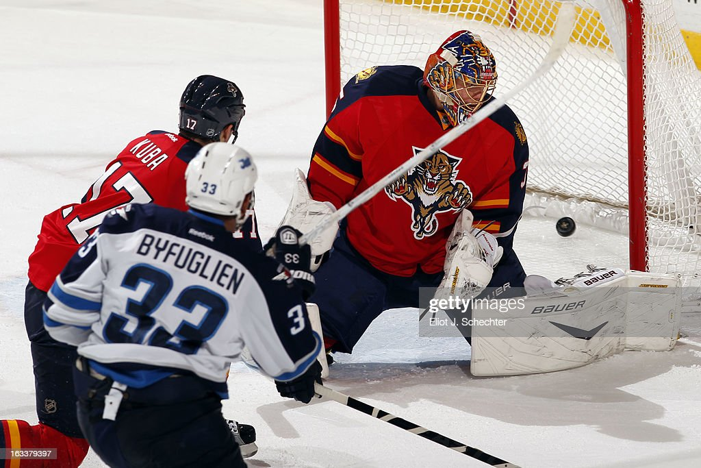 <a gi-track='captionPersonalityLinkClicked' href=/galleries/search?phrase=Dustin+Byfuglien&family=editorial&specificpeople=672505 ng-click='$event.stopPropagation()'>Dustin Byfuglien</a> #33 of the Winnipeg Jets shoots and scores the overtime winning goal against Goaltenter <a gi-track='captionPersonalityLinkClicked' href=/galleries/search?phrase=Jacob+Markstrom&family=editorial&specificpeople=5370948 ng-click='$event.stopPropagation()'>Jacob Markstrom</a> #35 of the Florida Panthers at the BB&T Center on March 8, 2013 in Sunrise, Florida.