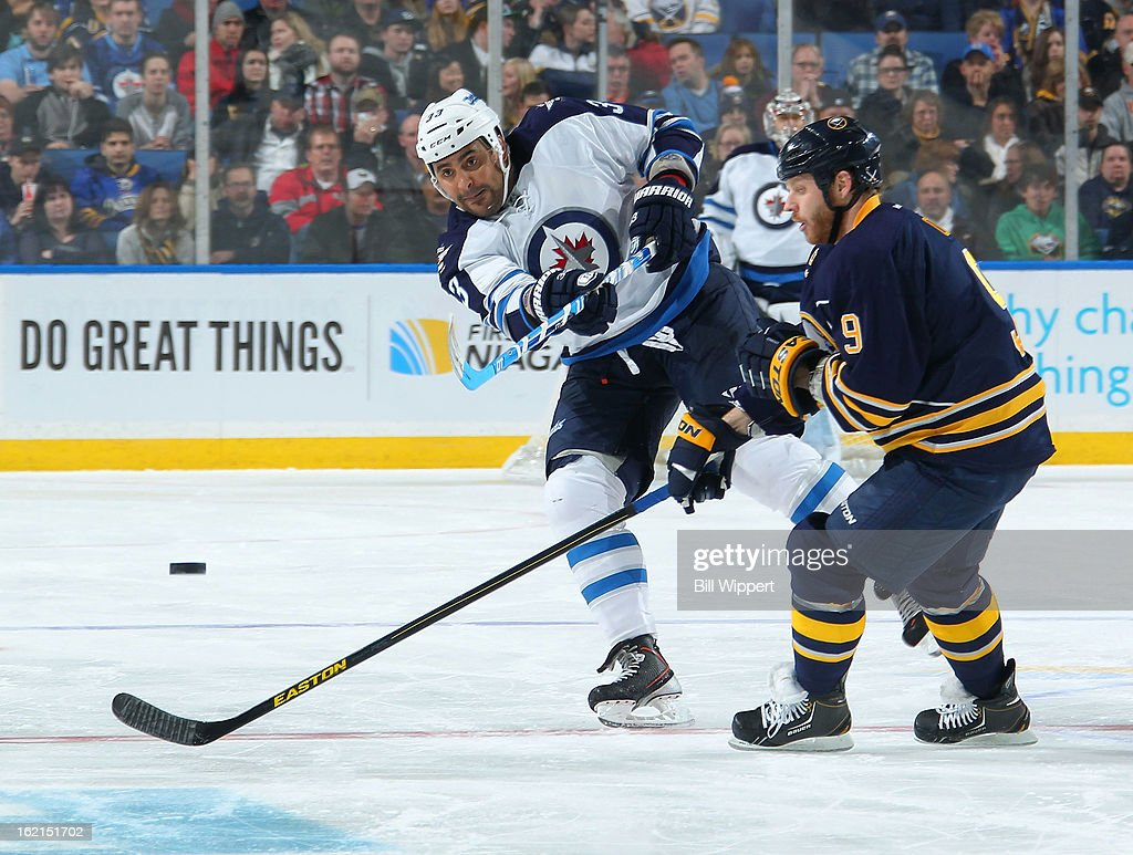 <a gi-track='captionPersonalityLinkClicked' href=/galleries/search?phrase=Dustin+Byfuglien&family=editorial&specificpeople=672505 ng-click='$event.stopPropagation()'>Dustin Byfuglien</a> #33 of the Winnipeg Jets shoots the puck past <a gi-track='captionPersonalityLinkClicked' href=/galleries/search?phrase=Steve+Ott&family=editorial&specificpeople=210616 ng-click='$event.stopPropagation()'>Steve Ott</a> #9 of the Buffalo Sabres on February 19, 2013 at the First Niagara Center in Buffalo, New York.