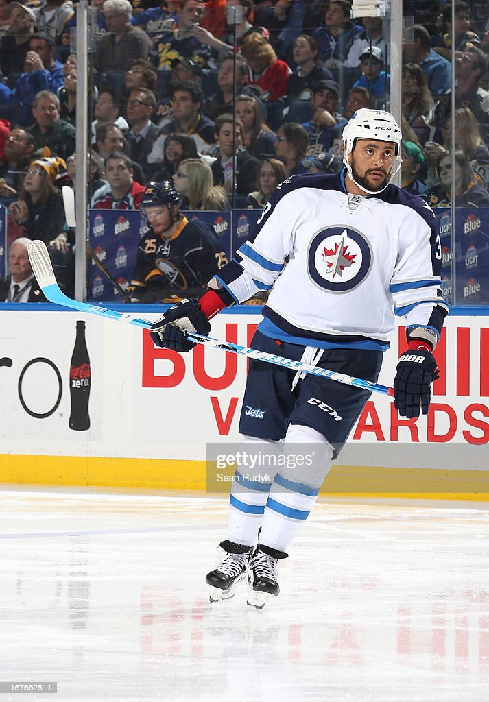 Dustin Byfuglien #33 of the Winnipeg Jets skates against the Buffalo Sabres at First Niagara Center on April 22, 2013 in Buffalo, New York.