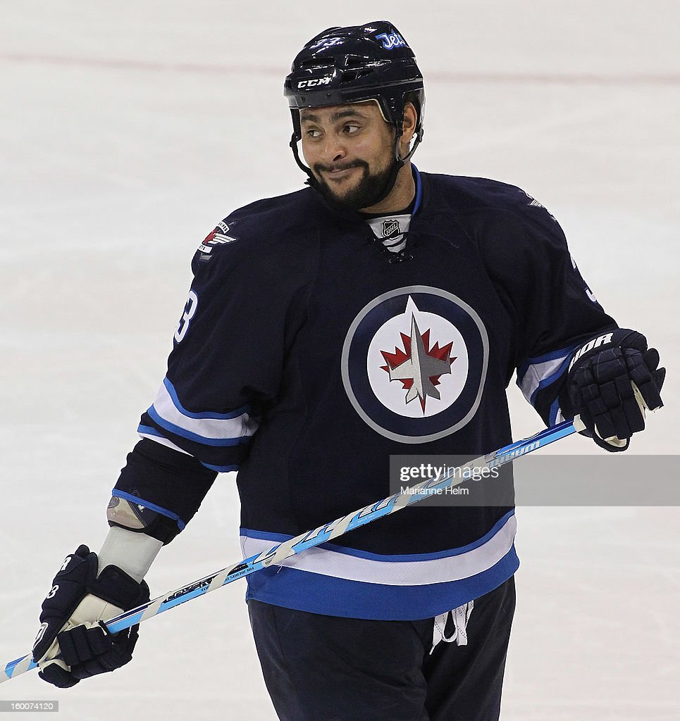 <a gi-track='captionPersonalityLinkClicked' href=/galleries/search?phrase=Dustin+Byfuglien&family=editorial&specificpeople=672505 ng-click='$event.stopPropagation()'>Dustin Byfuglien</a> #33 of the Winnipeg Jets smiles during the third period in a game against the Pittsburgh Penguins on January 25, 2013 at the MTS Centre in Winnipeg, Manitoba, Canada. The Winnipeg Jets defeated the Pittsburgh Penguins 4-2.