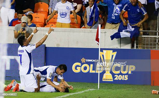 Dustin Corea of El Salvador bottom is mobbed by his teammates after scoring in the second half against Costa Rica at BBVA Compass Stadium on July 11...