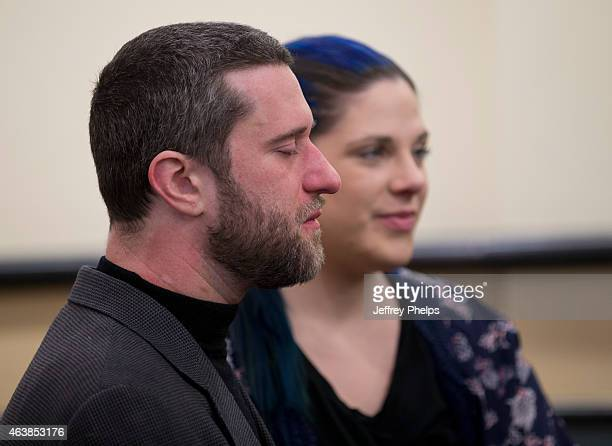 Dustin Diamond and Amanda Schutz wait in a courtroom as they attend further proceedings at Ozaukee County Courthouse on February 19 2015 in Port...