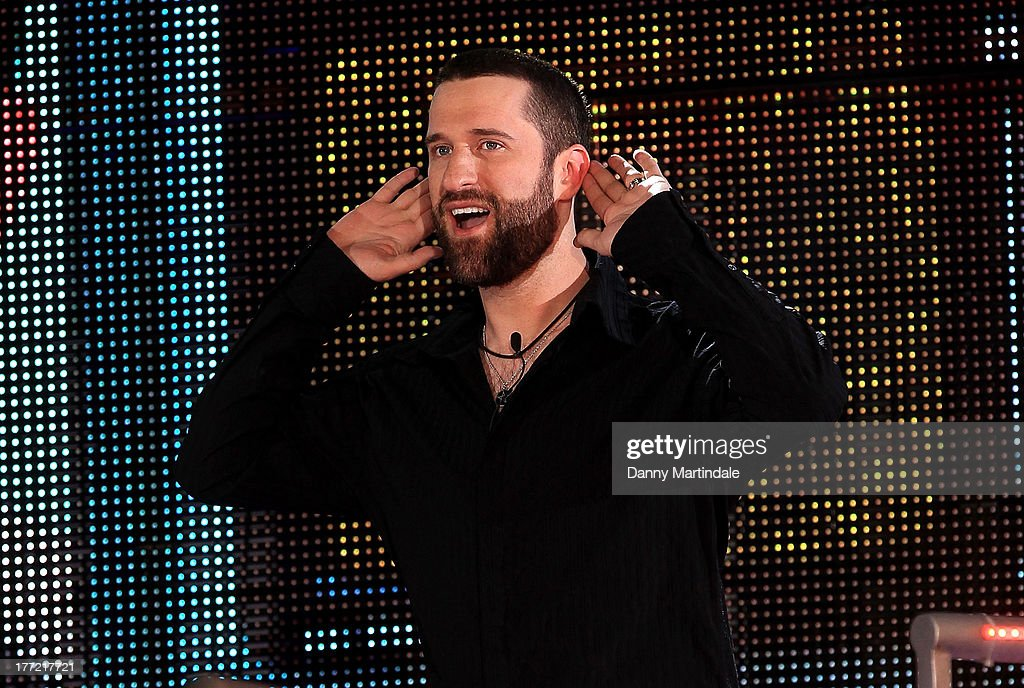 <a gi-track='captionPersonalityLinkClicked' href=/galleries/search?phrase=Dustin+Diamond&family=editorial&specificpeople=895493 ng-click='$event.stopPropagation()'>Dustin Diamond</a> enters the Celebrity Big Brother House at Elstree Studios on August 22, 2013 in Borehamwood, England.