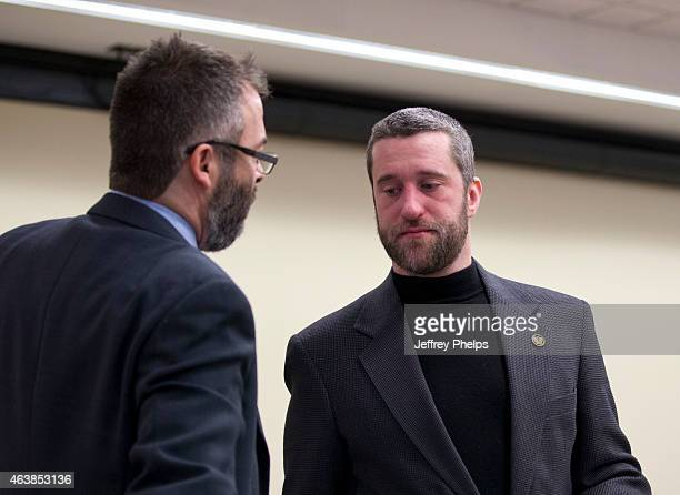 Dustin Diamond right leaves a courtroom after attending further proceedings at Ozaukee County Courthouse on February 19 2015 in Port Washington...