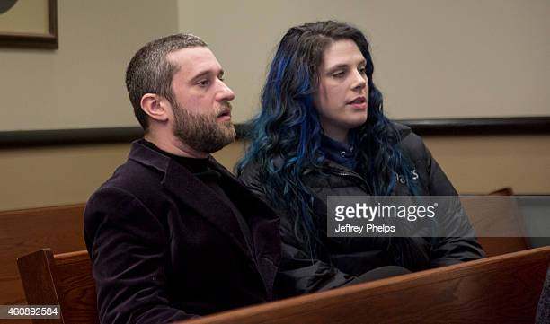 Dustin Diamond waits with Amanda Schutz for his status hearing at Ozaukee County Courthouse on December 29 2014 in Port Washington Wisconsin Diamond...
