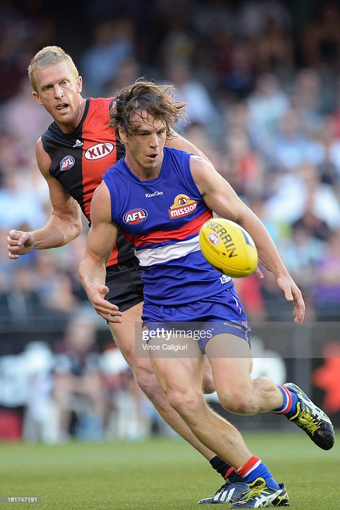 <a gi-track='captionPersonalityLinkClicked' href=/galleries/search?phrase=Dustin+Fletcher&family=editorial&specificpeople=216498 ng-click='$event.stopPropagation()'>Dustin Fletcher</a> of the bombers and Liam Picken of the bulldogs contest the ball during the round one AFL NAB Cup match between the Essendon Bombers and the Western Bulldogs at Etihad Stadium on February 15, 2013 in Melbourne, Australia.