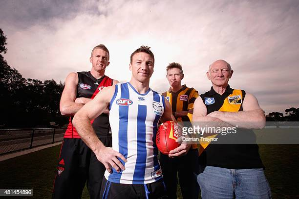 Dustin Fletcher of the Bombers Brent Harvey of the Kangaroos former Hawthorn great Michael Tuck and Richmond great Kevin Bartlett pose for a photo...