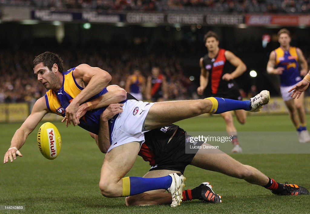 <a gi-track='captionPersonalityLinkClicked' href=/galleries/search?phrase=Dustin+Fletcher&family=editorial&specificpeople=216498 ng-click='$event.stopPropagation()'>Dustin Fletcher</a> of the Bombers tackles Jack Darling of the Eagles during the round seven AFL match between the Essendon Bombers and the West Coast Eagles at Etihad Stadium on May 12, 2012 in Melbourne, Australia.