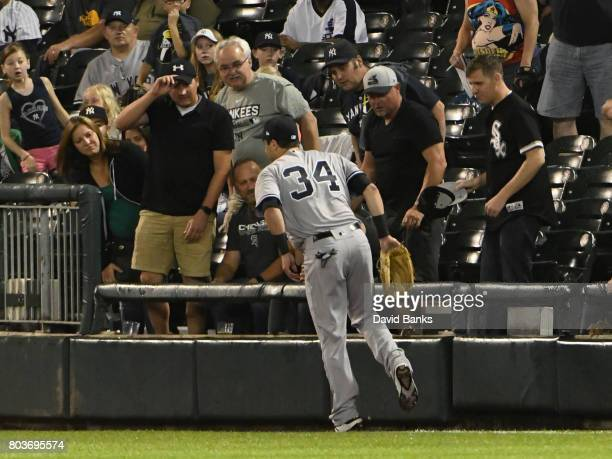 Dustin Fowler of the New York Yankees stands on one leg after trying to catch a foul ball hit by Jose Abreu of the Chicago White Sox Fowler had to...