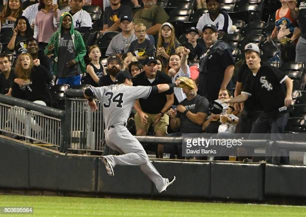 Dustin Fowler of the New York Yankees tries to catch a foul ball hit by Jose Abreu of the Chicago White Sox Fowler had to leave the game and was...