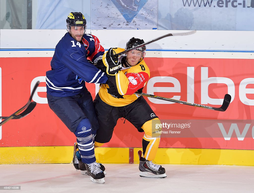 Dustin Friesen #14 of ERC Ingolstadt and Ville Koho #8 of SaiPa Lappeenranta fights for the puck during the Champions Hockey League group stage game between ERC Ingolstadt v SaiPa Lappeenranta on August 23, 2014 in Ingolstadt, Germany.