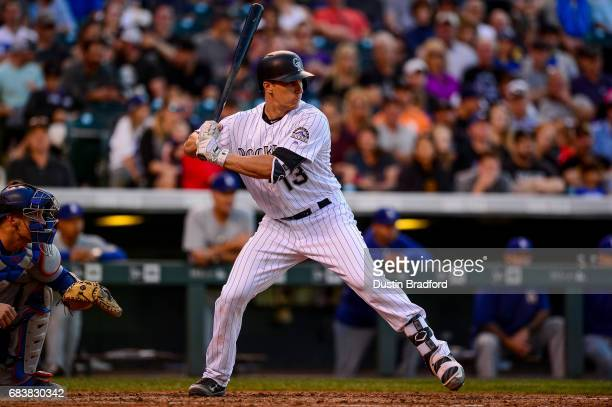 Dustin Garneau of the Colorado Rockies bats against the Los Angeles Dodgers in the second inning of a game against the Los Angeles Dodgers at Coors...