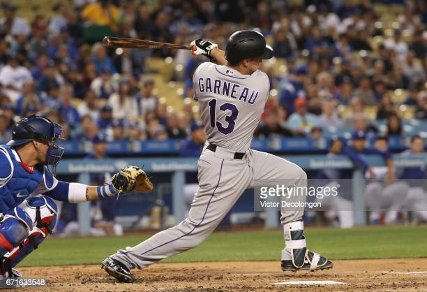 Dustin Garneau of the Colorado Rockies bats during the second inning of the MLB game against the Los Angeles Dodgers at Dodger Stadium on April 19...