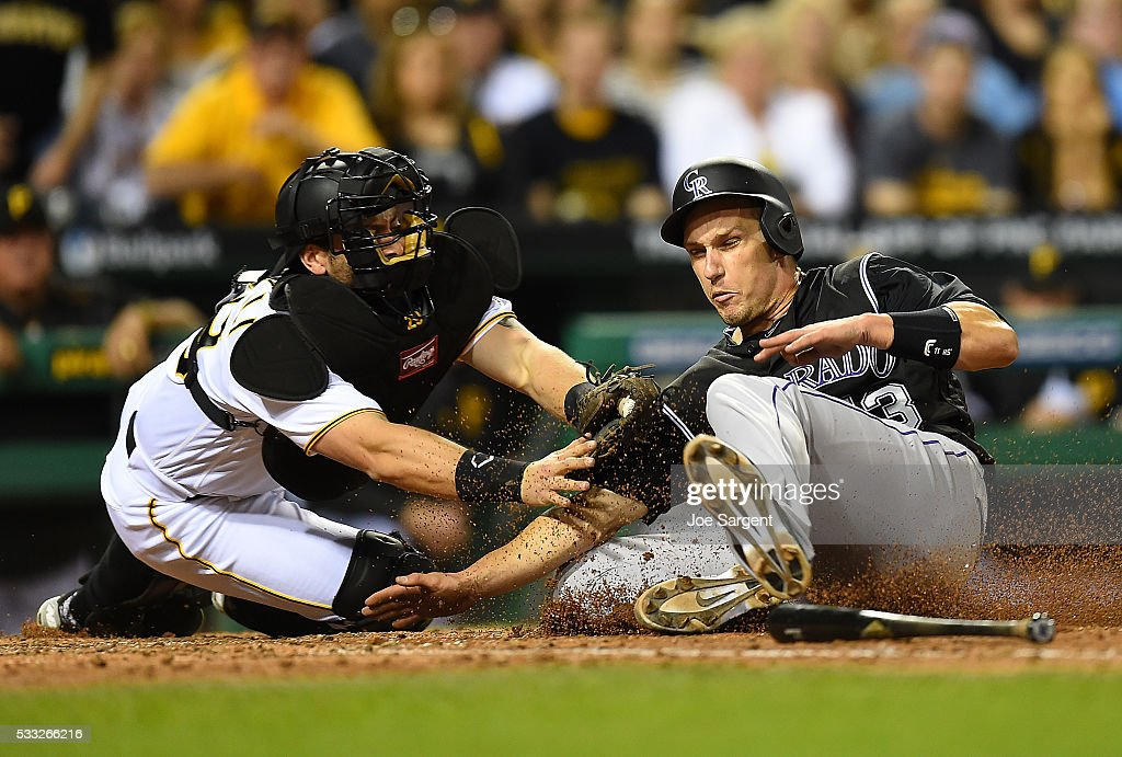 Dustin Garneau #13 of the Colorado Rockies is tagged out at home plate by <a gi-track='captionPersonalityLinkClicked' href=/galleries/search?phrase=Francisco+Cervelli&family=editorial&specificpeople=4172506 ng-click='$event.stopPropagation()'>Francisco Cervelli</a> #29 of the Pittsburgh Pirates during the seventh inning on May 20, 2016 at PNC Park in Pittsburgh, Pennsylvania.