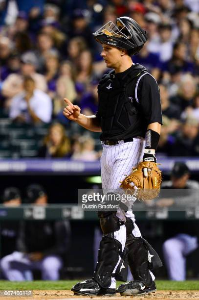 Dustin Garneau of the Colorado Rockies looks on in the eighth inning of a game against the Los Angeles Dodgers at Coors Field on April 8 2017 in...