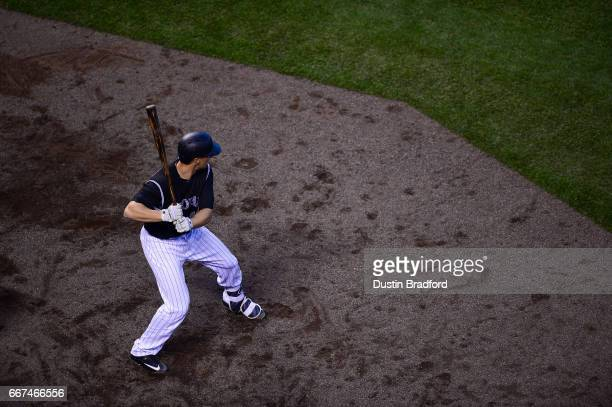 Dustin Garneau of the Colorado Rockies stands in the on deck circle in the fourth inning of a game against the Los Angeles Dodgers at Coors Field on...
