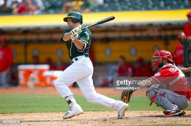 Dustin Garneau of the Oakland Athletics bats during the game against the Los Angeles Angels of Anaheim at the Oakland Alameda Coliseum on September 6...