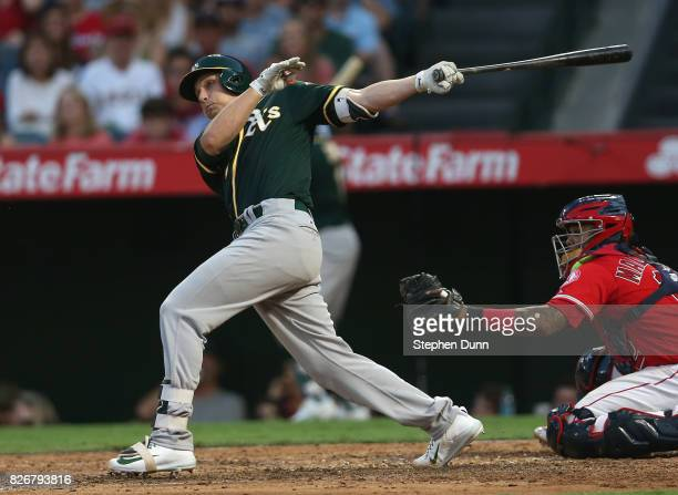 Dustin Garneau of the Oakland Athletics hits a two run single in the fourth inning against the Los Angeles Angels of Anaheim at Angel Stadium of...