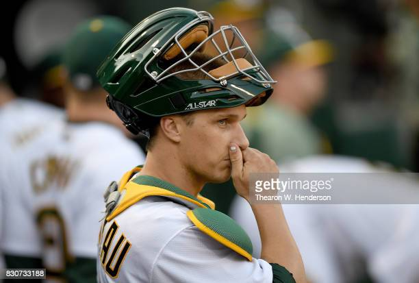 Dustin Garneau of the Oakland Athletics looks on from the dugout prior to the start of the game against the Baltimore Orioles at Oakland Alameda...