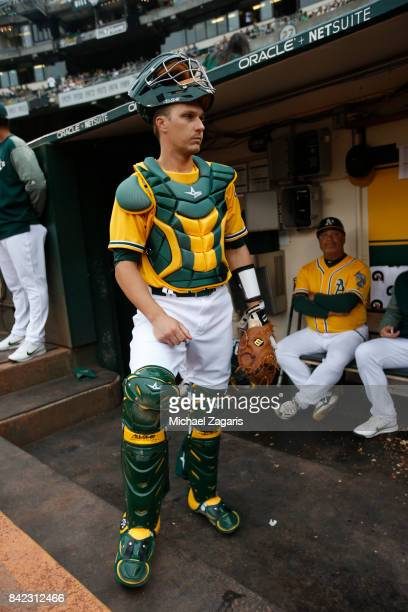 Dustin Garneau of the Oakland Athletics stands in the dugout prior to the game against the Seattle Mariners at the Oakland Alameda Coliseum on August...