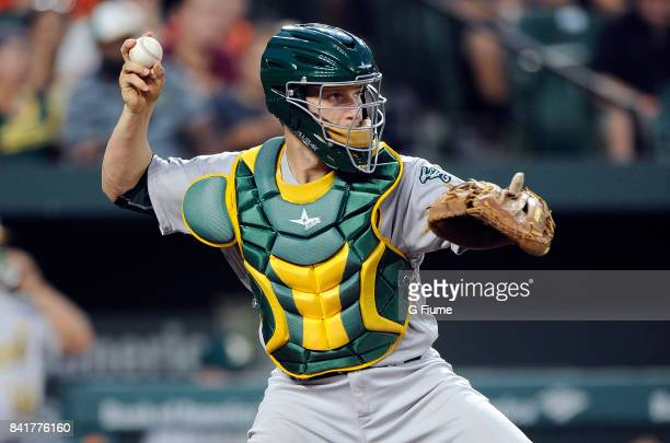 Dustin Garneau of the Oakland Athletics throws the ball to second base against the Baltimore Orioles at Oriole Park at Camden Yards on August 21 2017...