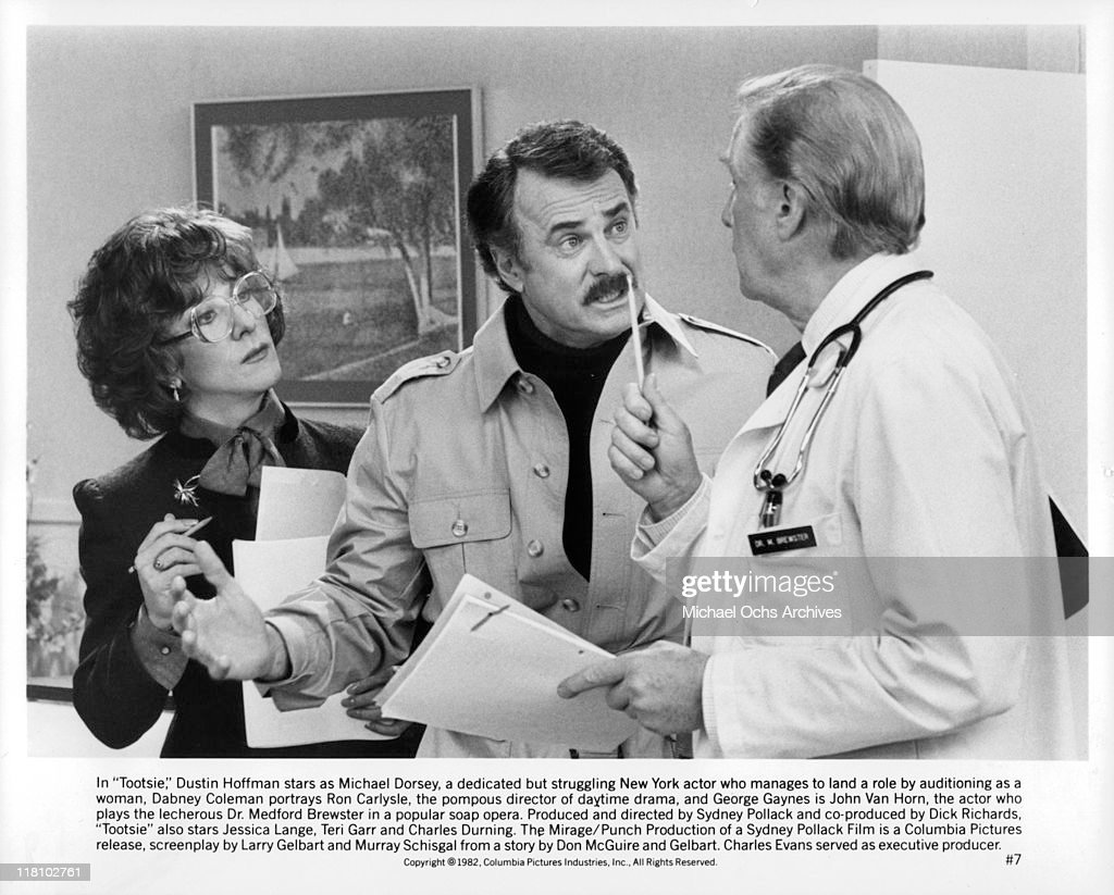 Dustin Hoffman look on as Dabney Coleman and George Gaynes argue in a scene from the film 'Tootsie', 1982.