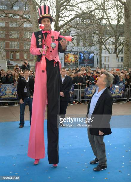 Dustin Hoffman looks up to a man on stilts as he arrives for the UK film premiere of Mr Magorium's Wonder Emporium at the Empire cinema in Leicester...