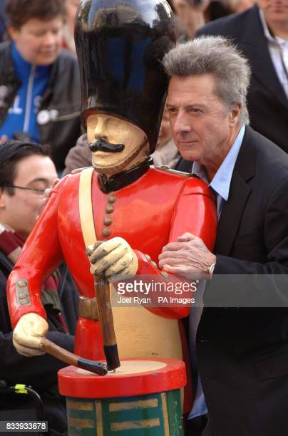 Dustin Hoffman poses with a toy soldier as he arrives for the UK film premiere of Mr Magorium's Wonder Emporium at the Empire cinema in Leicester...