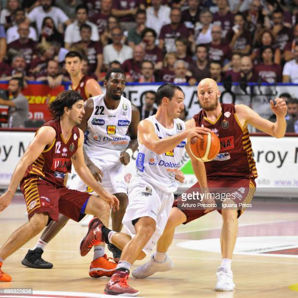 Dustin Hogue and Aaron Craft of Dolomiti competes with Hrvoje Peric and Ariel Filloy of Umana during the match game 2 of play off final series of LBA...