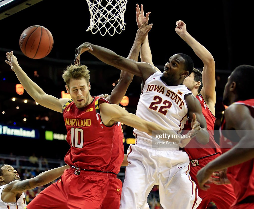 Dustin Hogue (22) of the Iowa State Cyclones blocks a shot by <a gi-track='captionPersonalityLinkClicked' href=/galleries/search?phrase=Jake+Layman&family=editorial&specificpeople=9973489 ng-click='$event.stopPropagation()'>Jake Layman</a> (10) of the Maryland Terrapins during the CBE Hall Of Fame Classic final game at Sprint Center on November 25, 2014 in Kansas City, Missouri.