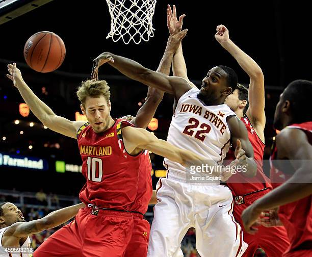 Dustin Hogue of the Iowa State Cyclones blocks a shot by Jake Layman of the Maryland Terrapins during the CBE Hall Of Fame Classic final game at...