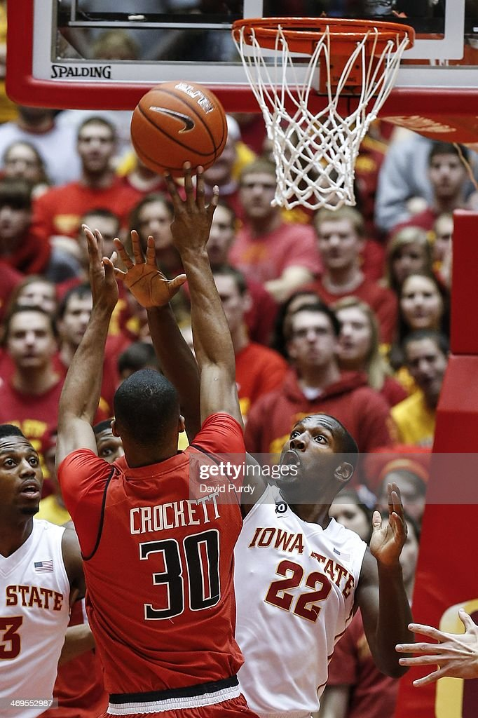 Dustin Hogue #22 of the Iowa State Cyclones blocks as Jaye Crockett #30 of the Texas Tech Red Raiders takes a shot in the first half of play at Hilton Coliseum on February 15, 2014 in Ames, Iowa. Iowa State defeated Texas Tech 70-64.