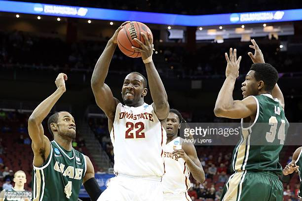 Dustin Hogue of the Iowa State Cyclones goes to the hoop against Robert Brown and William Lee of the UAB Blazers during the second round of the 2015...