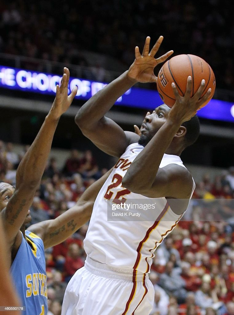Dustin Hogue #22 of the Iowa State Cyclones puts up a shot as <a gi-track='captionPersonalityLinkClicked' href=/galleries/search?phrase=Keith+Davis&family=editorial&specificpeople=580211 ng-click='$event.stopPropagation()'>Keith Davis</a> #4 of the Southern University Jaguars blocks in the first half of play at Hilton Coliseum on December 14, 2014 in Ames, Iowa. Iowa State defeated the Southern Jaguars 88-78.