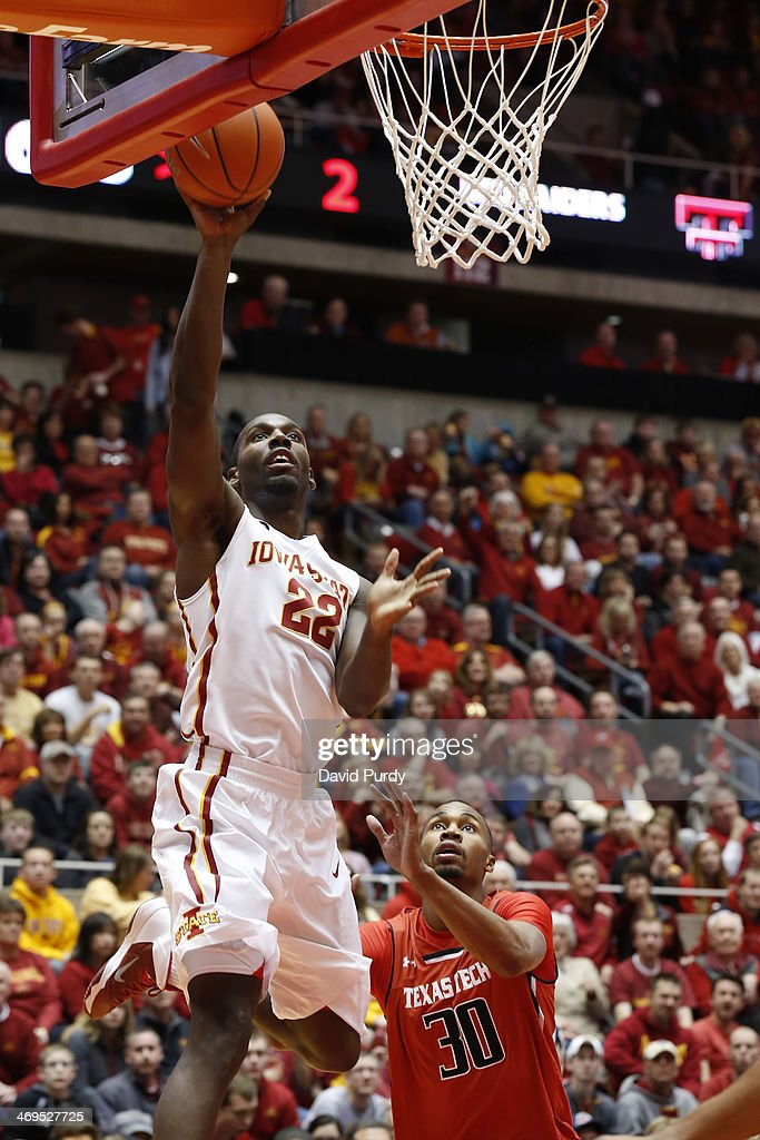 Dustin Hogue #22 of the Iowa State Cyclones takes a shot under the basket as Jaye Crockett #30 of the Texas Tech Red Raiders defends in the first half of play at Hilton Coliseum on February 15, 2014 in Ames, Iowa.