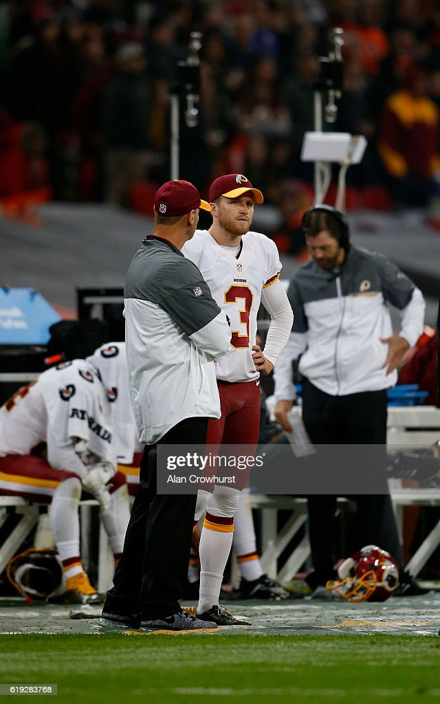 Dustin Hopkins #3 of the Washington Redskins stands on the sideline after missing a game-winning field goal in overtime during the NFL International Series game against the Cincinnati Bengals at Wembley Stadium on October 30, 2016 in London, England.