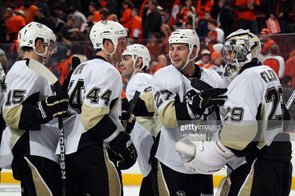 Dustin Jeffrey #15, Brooks Orpik #44, Craig Adams #27 and Marc-Andre Fleury #29 of the Pittsburgh Penguins celebrate after defeating the Philadelphia Flyers 3-1 on January 19, 2013 at the Wells Fargo Center in Philadelphia, Pennsylvania.