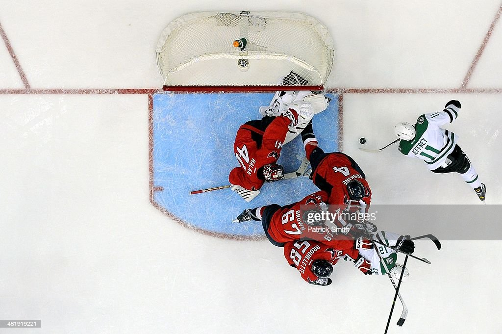 <a gi-track='captionPersonalityLinkClicked' href=/galleries/search?phrase=Dustin+Jeffrey&family=editorial&specificpeople=4170179 ng-click='$event.stopPropagation()'>Dustin Jeffrey</a> #11 of the Dallas Stars scores a goal on <a gi-track='captionPersonalityLinkClicked' href=/galleries/search?phrase=Jaroslav+Halak&family=editorial&specificpeople=2285591 ng-click='$event.stopPropagation()'>Jaroslav Halak</a> #41 of the Washington Capitals in the second period during an NHL game at Verizon Center on April 1, 2014 in Washington, DC.