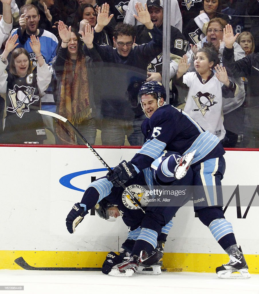 <a gi-track='captionPersonalityLinkClicked' href=/galleries/search?phrase=Dustin+Jeffrey&family=editorial&specificpeople=4170179 ng-click='$event.stopPropagation()'>Dustin Jeffrey</a> #15 of the Pittsburgh Penguins celebrates his third period goal with <a gi-track='captionPersonalityLinkClicked' href=/galleries/search?phrase=Tyler+Kennedy&family=editorial&specificpeople=2119414 ng-click='$event.stopPropagation()'>Tyler Kennedy</a> #48 of the Pittsburgh Penguins against the Florida Panthers during the game at Consol Energy Center on February 22, 2013 in Pittsburgh, Pennsylvania. The Penguins won 3-1.