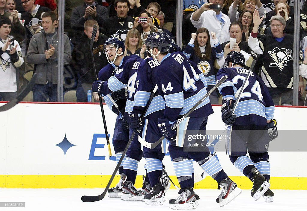 <a gi-track='captionPersonalityLinkClicked' href=/galleries/search?phrase=Dustin+Jeffrey&family=editorial&specificpeople=4170179 ng-click='$event.stopPropagation()'>Dustin Jeffrey</a> #15 of the Pittsburgh Penguins celebrates his third period goal against the Florida Panthers during the game at Consol Energy Center on February 22, 2013 in Pittsburgh, Pennsylvania. The Penguins won 3-1.