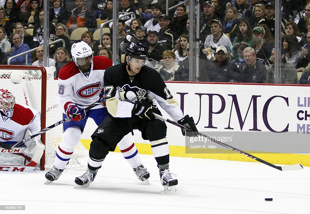 Dustin Jeffrey #17 of the Pittsburgh Penguins handles the puck in front of P.K. Subban #76 of the Montreal Canadiens during the game at Consol Energy Center on March 26, 2013 in Pittsburgh, Pennsylvania.