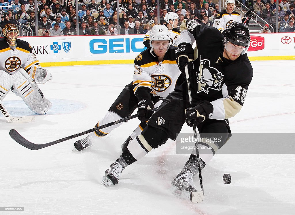<a gi-track='captionPersonalityLinkClicked' href=/galleries/search?phrase=Dustin+Jeffrey&family=editorial&specificpeople=4170179 ng-click='$event.stopPropagation()'>Dustin Jeffrey</a> #15 of the Pittsburgh Penguins tries to control the loose puck in front of Dougie Hamilton #27 of the Boston Bruins on March 12, 2013 at Consol Energy Center in Pittsburgh, Pennsylvania. Pittsburgh won the game 3-2.