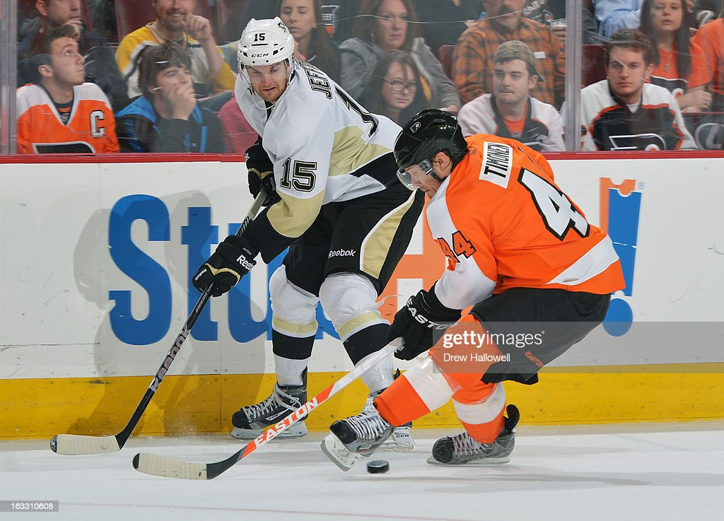 Dustin Jeffrey #15 of the Pittsburgh Penguins tries to get the puck past Kimmo Timonen #44 of the Philadelphia Flyers at the Wells Fargo Center on March 7, 2013 in Philadelphia, Pennsylvania. The Penguins won 5-4.