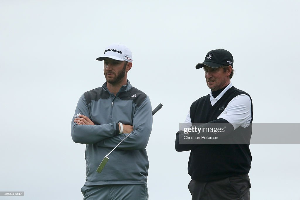 Dustin Johnson and former professional hockey player Wayne Gretzky look on during the final round of the AT&T Pebble Beach National Pro-Am at the Pebble Beach Golf Links on February 9, 2014 in Pebble Beach, California.